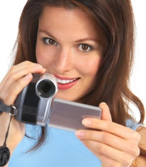 woman-with-video-camera-camcorder